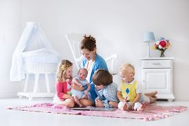 picture of bassinet  - Mother and children play indoors - JPG