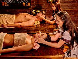 image of panchakarma  - Couple  having oil Ayurveda spa treatment - JPG