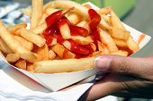 picture of french fries  - French fries and ketchup at the restaurant - JPG