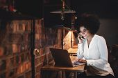 Happy Businesswoman Working Late In Office poster