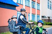 Family Cycling, Mother With Happy Kid Riding Bike Outdoors poster