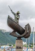Statue Of A Whaler In A Boat  In Main Square In Tromso, Norway. poster