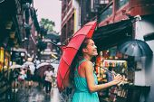 People lifestyle umbrella travel Asian woman shopping in chinatown market street. Rainy day girl tou poster