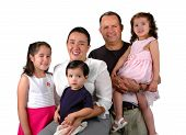 stock photo of latin people  - Latin family smiling isolated over a white background - JPG