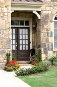 stock photo of manicured lawn  - Close up of a front door with umbrella with manicured lawn - JPG