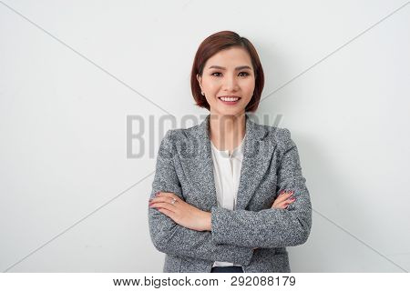 poster of Entrepreneur Young Asian Woman, Business Woman Arms Crossed On White Background.