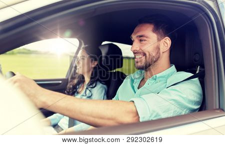 poster of leisure, road trip, travel, family and people concept - happy man and woman driving in car