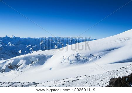 Snowy Peaks Of Caucasian Mountains