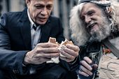 Sincere Kind Man In Office Costume Sharing Sandwich With Homeless Man poster