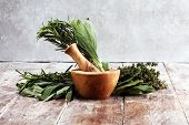 Homegrown And Aromatic Herbs On Rustic Background With Rosemary And Basil poster