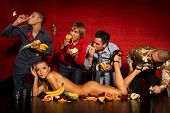 image of snatch  - Four guys having fun with woman decorated  by fruits - JPG