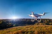 Close up on white drone camera. Drone quadcopter in flight poster