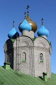 stock photo of murmansk  - Onion shape cupola and green roof of new russian church in Murmansk Russia - JPG