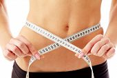 picture of meter stick  - woman measure her waist belly by metre - JPG