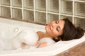 image of black woman spa  - Sensual sexy woman relaxing in bath foam - JPG