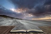 Beautiful Winter Sunrise Over West Wittering Beach In Sussex England With Wind Blowing Sand Across T poster