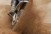 Rider Driving In The Motocross Race The Rear Wheel Motocross Bike poster