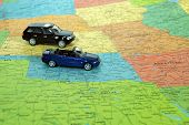 picture of united states map  - Cars traveling on a United States map - JPG