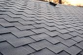 Close Up View On Asphalt Roofing Shingles Background. Roof Shingles - Roofing. Roof Shingles Covered poster