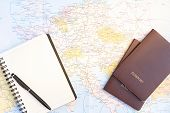 Passport On Europe Map Background.travel Planning.top View Of Traveler Accessories With Two Passport poster
