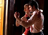 stock photo of tango  - A man and a woman dancing argentinian tango - JPG