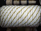 White Rope On A Show-window Of Shop. A Safety Rope For Climbers. The Rope Is Reeled Up On The Coil.  poster
