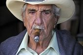 Old man smoke a cigar