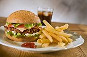 picture of junk food  - cheeseburger french fries and on a plate - JPG