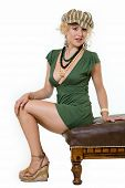 picture of clevage  - Full body of an attractive woman with curly blond hair in a sexy short green dress and accessories standing on white - JPG