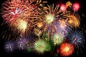 foto of firework display  - Fireworks display in grand finale over dark background - JPG