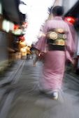 Japan Kyoto Pontocho-dori Woman wearing kimono walking on narrow street motion blur