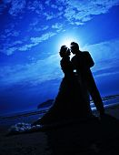 stock photo of sweetheart  - Silhouette couple love and romantic on the beach