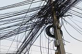foto of utility pole  - Tangle of Electrical Wires on Power Pole - JPG
