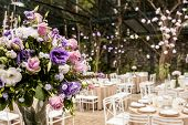 stock photo of banquet  - Bouquet of flowers in a ballroom - JPG
