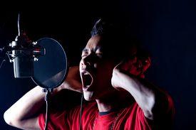 foto of recording studio  - the male artist recording in the studio - JPG