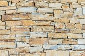 stock photo of old stone fence  - abstract part of an old fence of stone lined - JPG