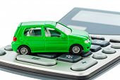 image of income tax  - a car is on a calculator - JPG