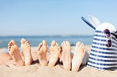 picture of sunbathing woman  - hats and summer concept  - JPG