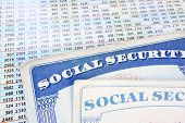 stock photo of social-security  - Social Security cards and a sheet of budget numbers - JPG