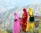 stock photo of indian sari  - Indian women in colorful saris looking from top of hill - JPG