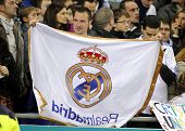 BARCELONA - JAN, 12: Supporter of Real Madrid holds up a flag during a Spanish League match between