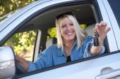 image of car keys  - Attractive Happy Woman In New Car with Keys - JPG