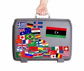 stock photo of libya  - Used plastic suitcase with lots of small stickers large sticker of Libya - JPG