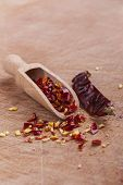 image of red hot chilli peppers  - Dry red hot chilli peppers with wooden spoon on brown wood background