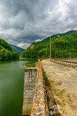 pic of hydro  - Small hydro electric dam harnessing water power in a mountain area - JPG