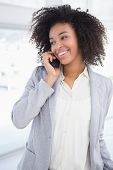 stock photo of half-dressed  - Casual businesswoman talking on phone in her office - JPG