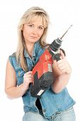 Young Blonde Woman Works With A Cordless Electric Screwdriver