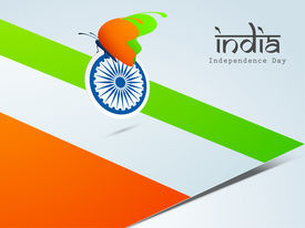 stock photo of asoka  - Beautiful butterfly in saffron and green colors with Asoka Wheel on national flag background for Indian Independence Day celebrations - JPG