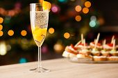 foto of apricot  - A glass of sparkling wine with apricot on the table - JPG