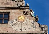 picture of sundial  - Detail of old sundial on the side of Fembohaus Stadtmuseum in Nuremberg Germany - JPG